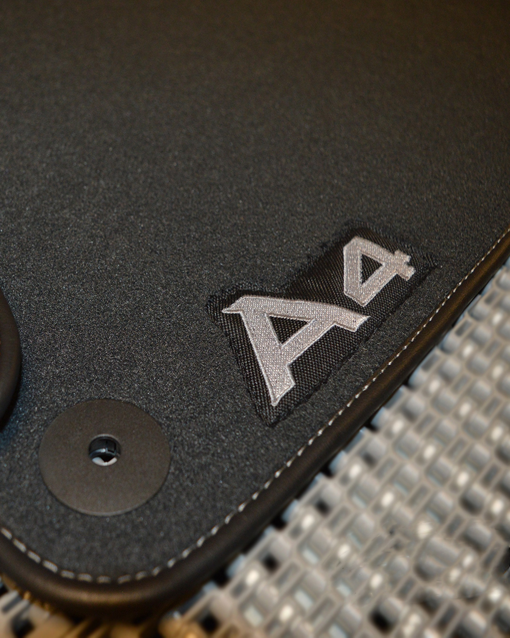 A4 Logo on mats close up