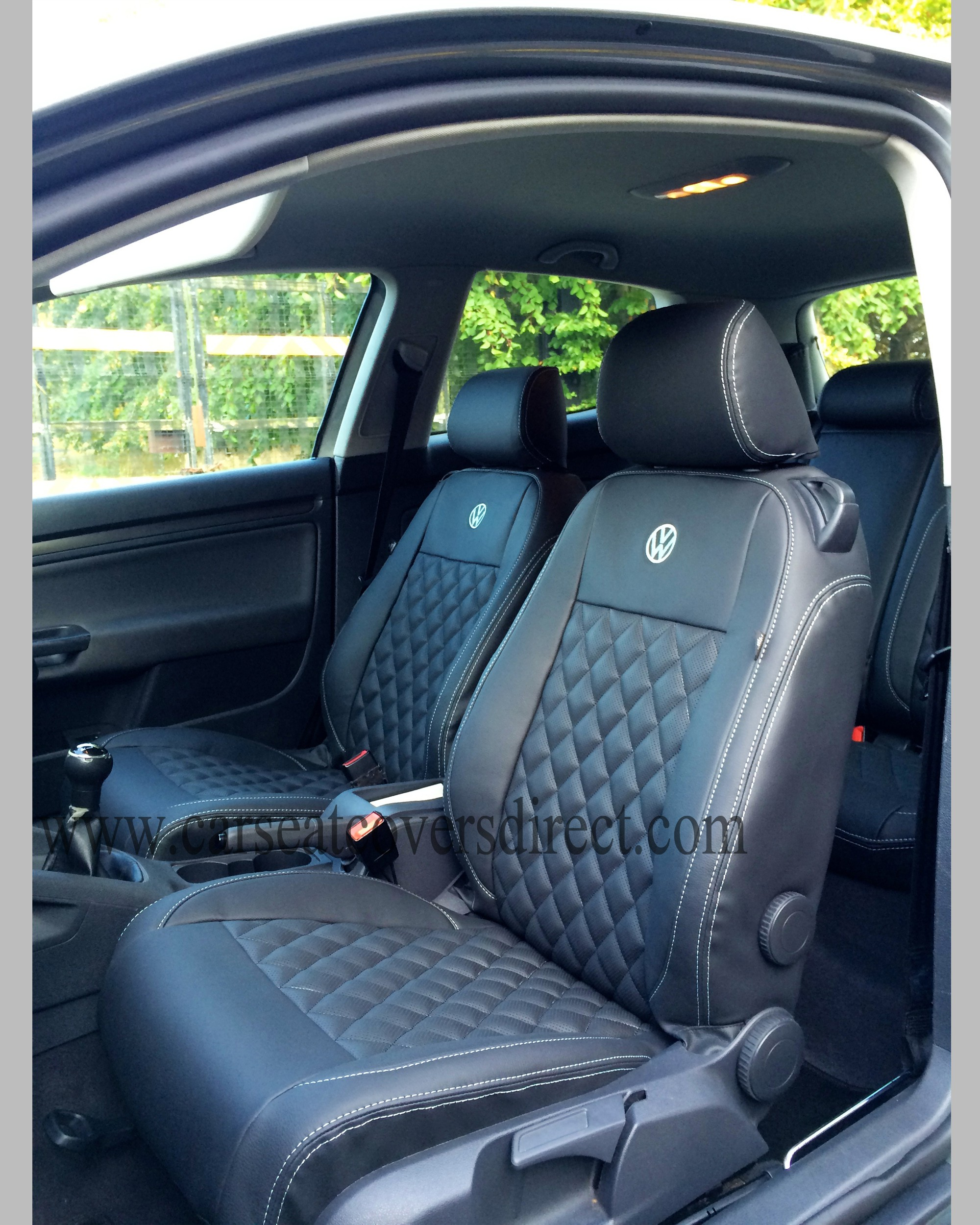 Passenger seat with diamond quilted seat covers fitted
