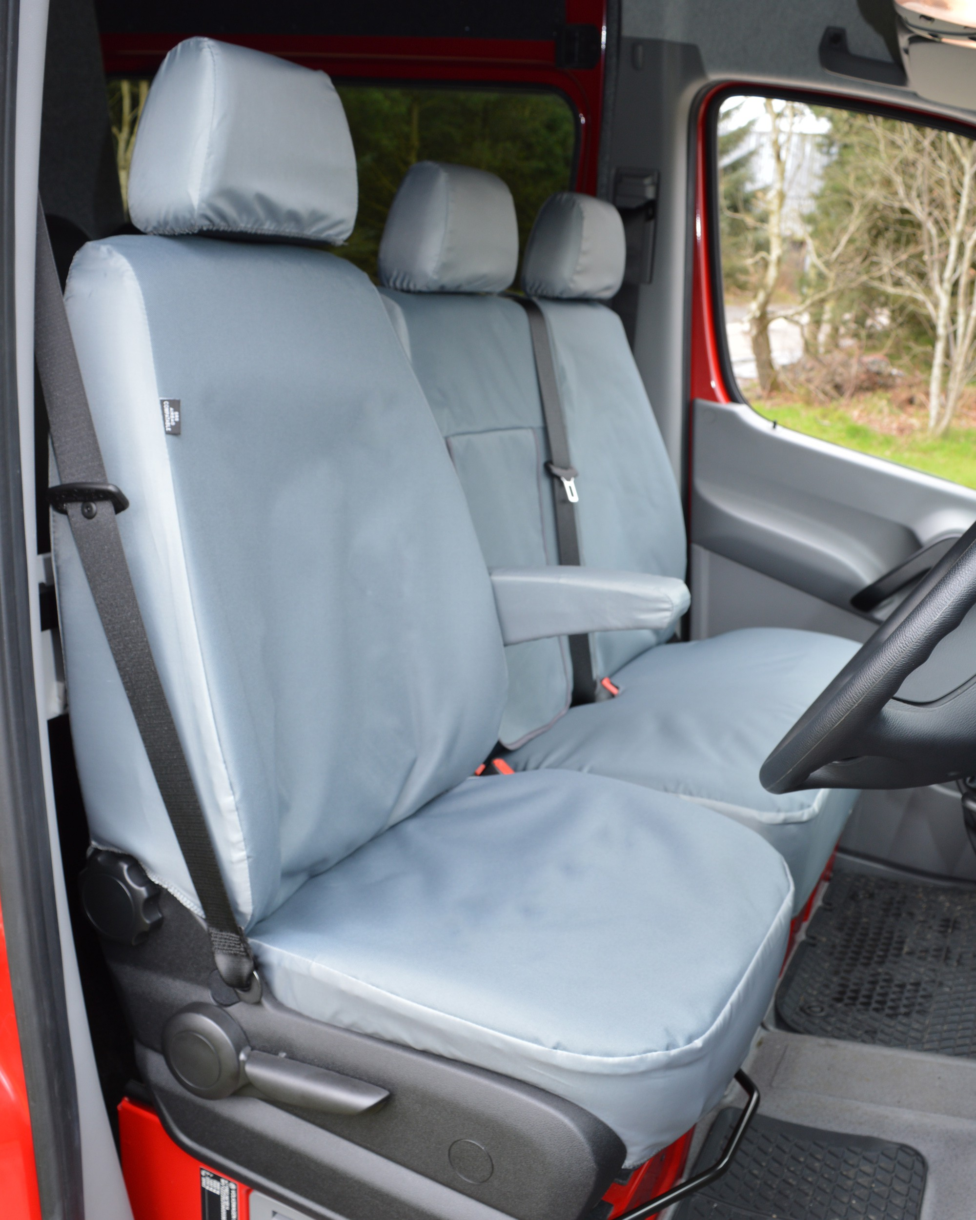 Drivers seat with extra heavy duty grey seat covers